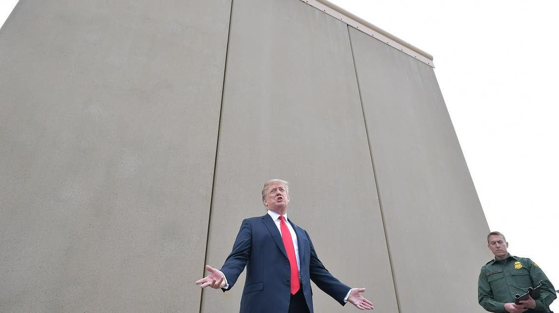 In this file photo taken on March 13, 2018 US President Donald Trump inspects border wall prototypes with Chief Patrol Agent Rodney S. Scott in San Diego, California. (AFP)