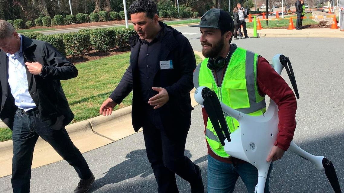 Matternet CEO Andreas Raptopoulos walks next to an operator carrying a drone used for delivery of medical specimens after a flight at WakeMed Hospital in Raleigh, North Carolina on March 26, 2019. (AP)