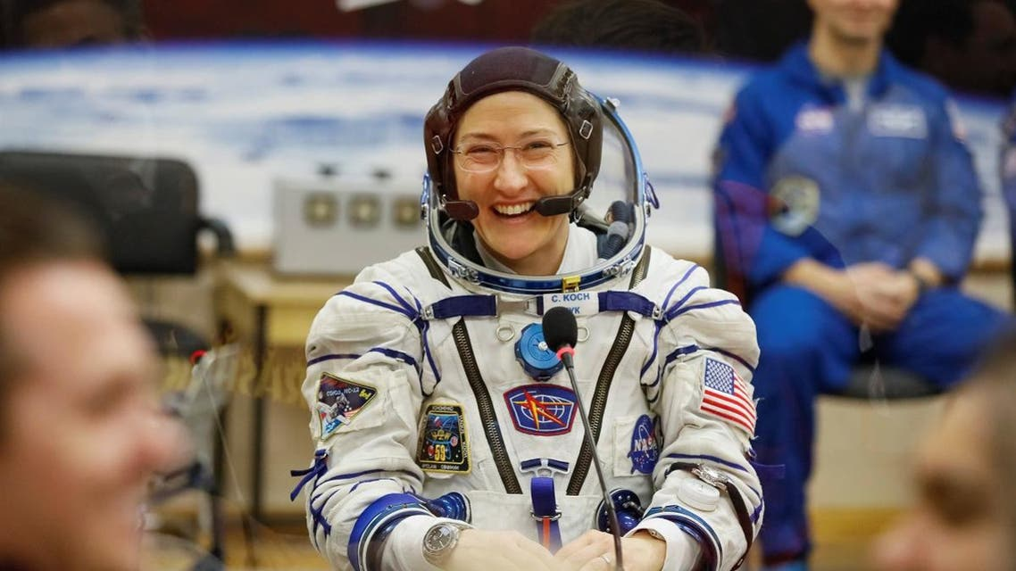 The International Space Station (ISS) crew member Christina Koch of the US smiles after donning a space suit shortly before launch at the Baikonur Cosmodrome. (Reuters)