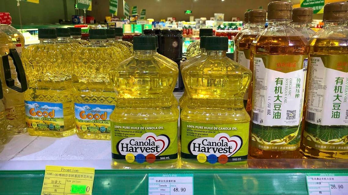 Bottles of Canola Harvest brand canola oil, manufactured by Canadian agribusiness firm Richardson International, are seen on the shelf of a grocery store in Beijing. (AP)