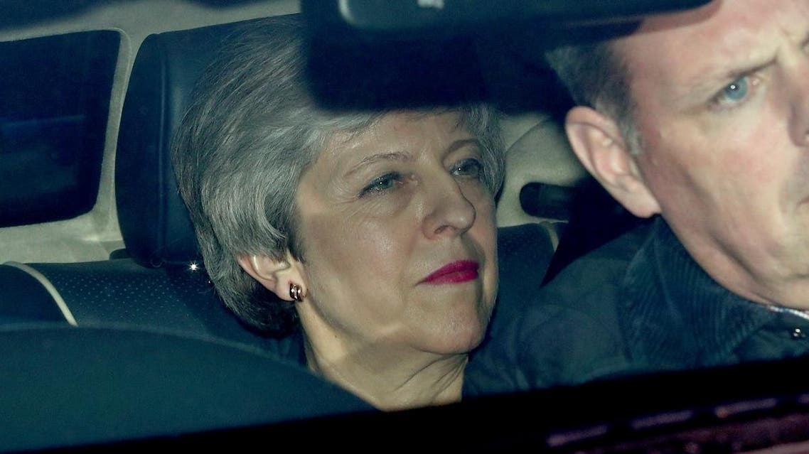 Britain's Prime Minister Theresa May is seen in a car outside the Houses of Parliament in London. (Reuters)