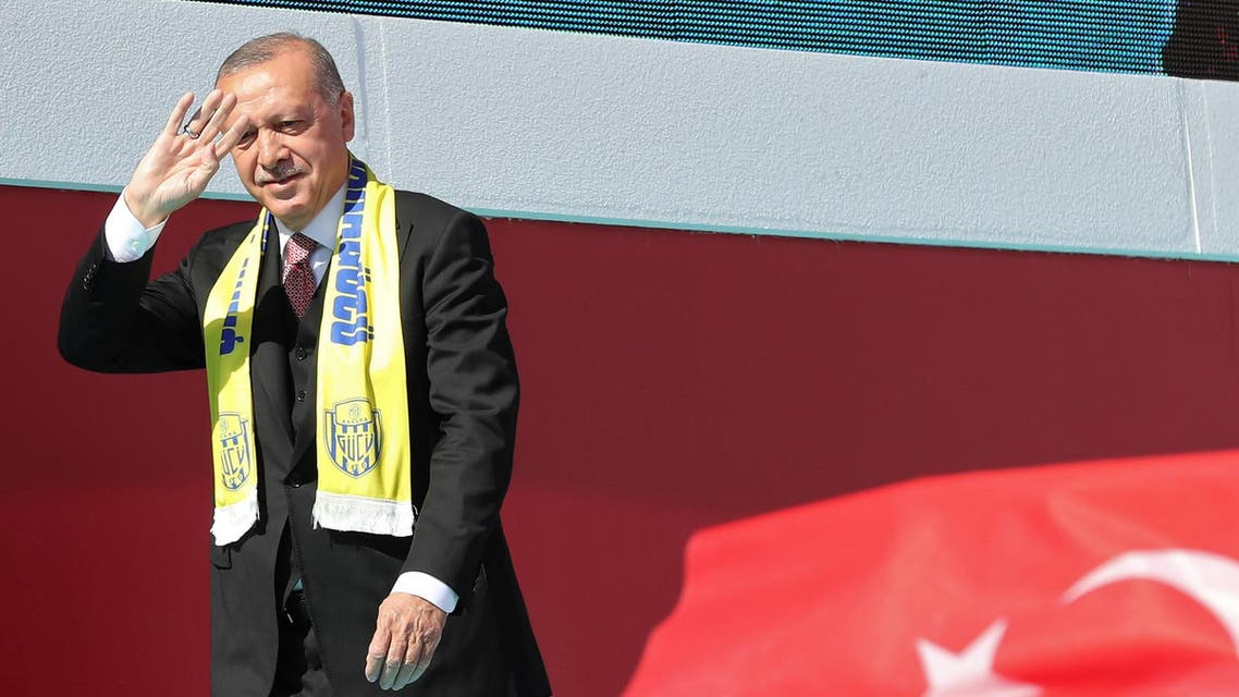 Turkish President Recep Tayyip Erdogan walks on stage during a local election campaign rally in Ankara, Turkey, on March 23, 2019. (AFP)