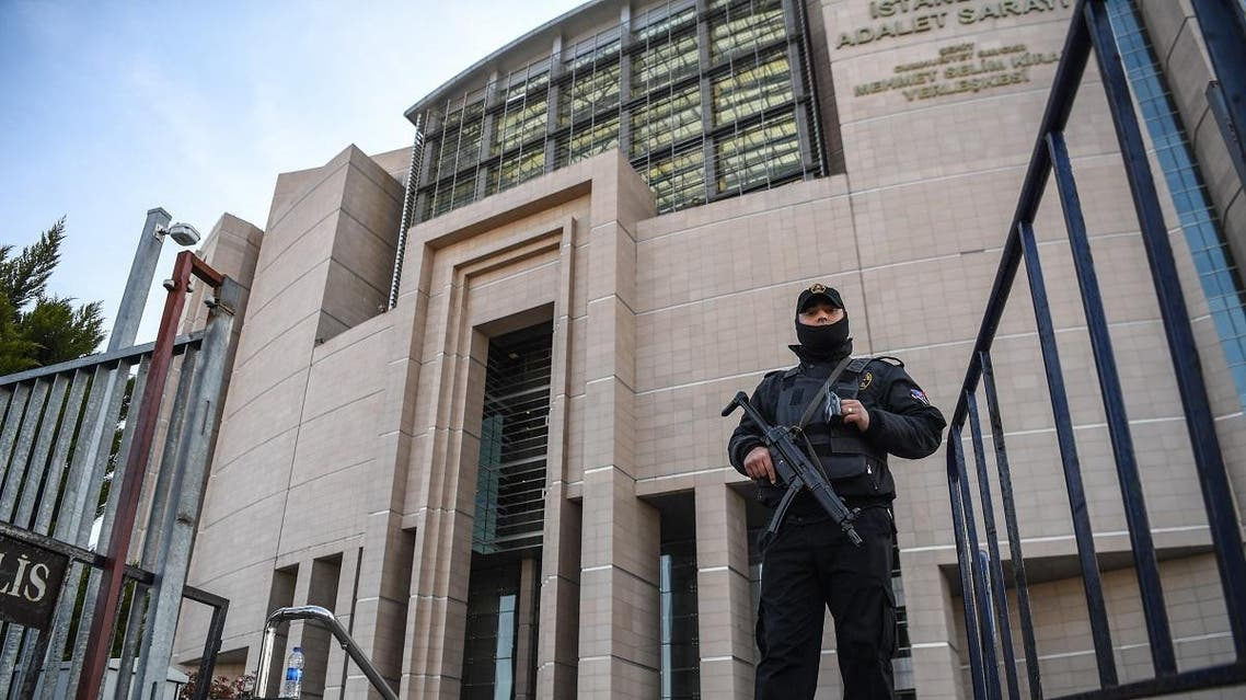 A Turkish policeman stands guard outside the courthouse in Istanbul on March 28, 2019, during the trial of Metin Topuz, an US consulate staffer accused of spying and attempting to overthrow the government. (AFP)