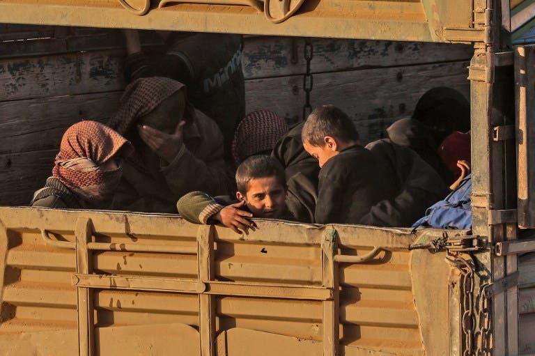 أطفال خارجون من الباغوز(أرشيفية- فرانس برس)