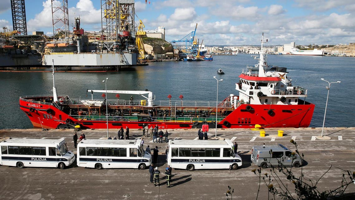 Police buses await migrants who arrived on merchant ship Elhiblu 1, in Valletta's Grand Harbour, Malta, on March 28, 2019. (Reuters)