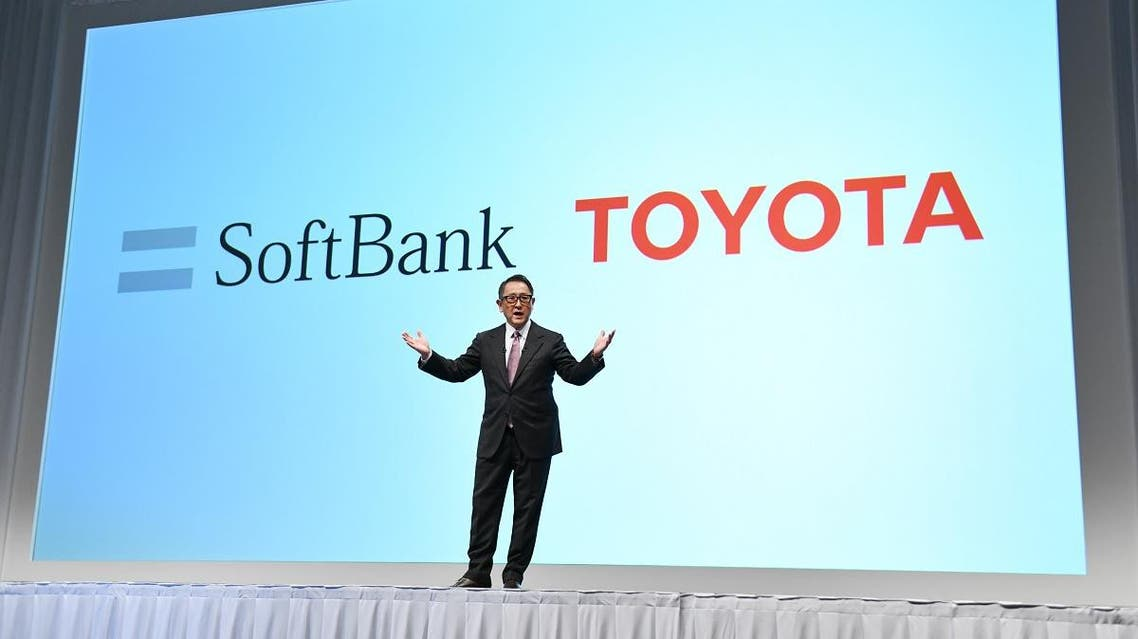 Toyota Motor president Akio Toyoda delivers a speech during a joint press conference with SoftBank in Tokyo. (AFP)