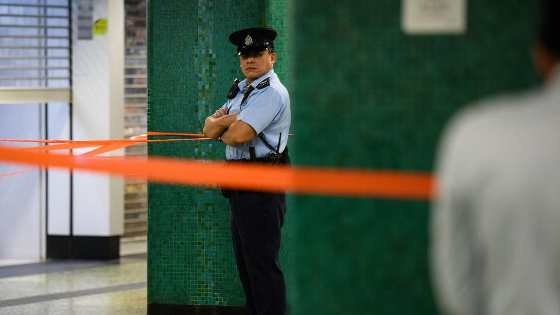 Police stand guard in Sham Shui Po MTR underground station in Hong Kong on November 7, 2018. (AFP)