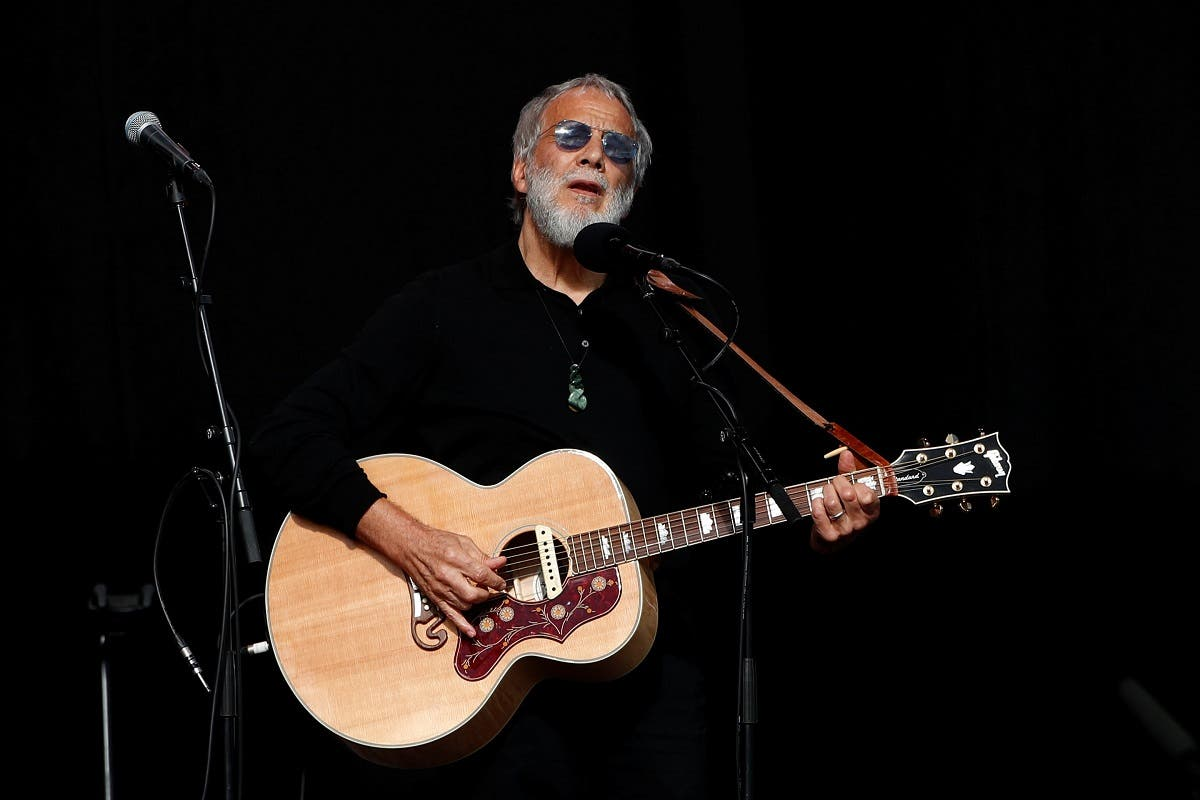 Yusof Islam, formerly known as Cat Stevens, performs at the national remembrance service for victims of the mosque attacks. (Reuters)