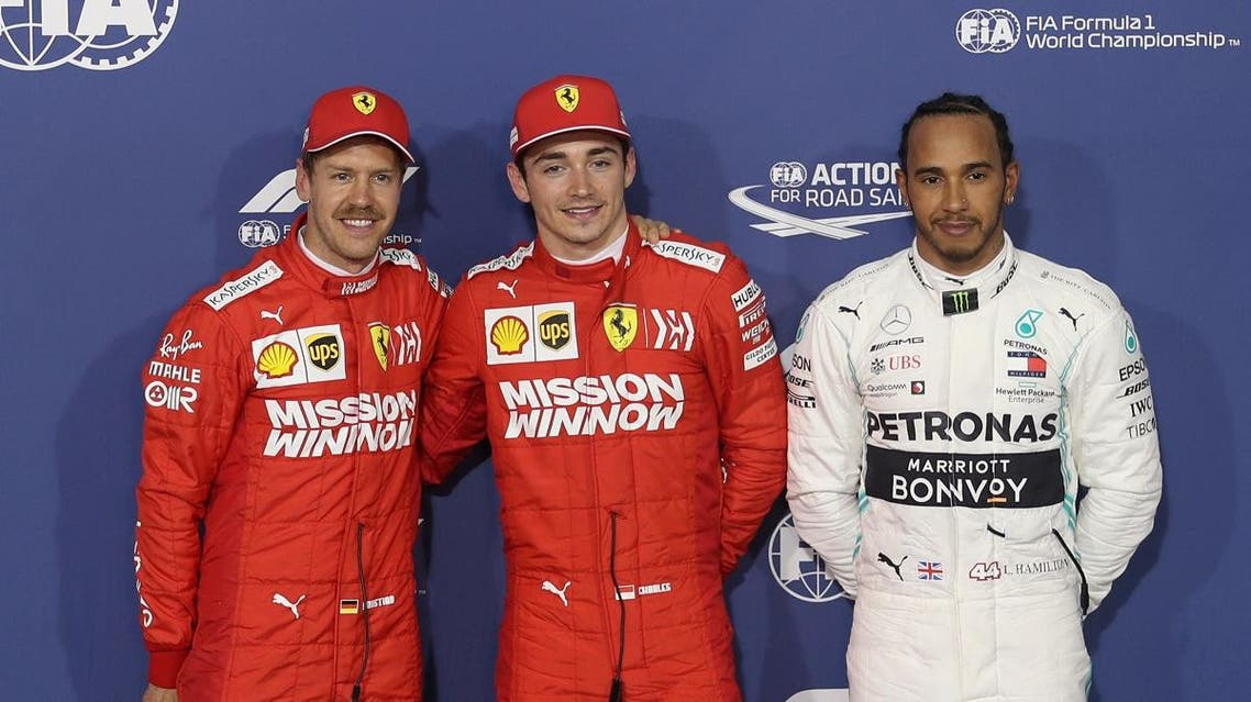 Ferrari's Charles Leclerc celebrates on the podium after qualifying in pole position alongside second placed Ferrari's Sebastian Vettel and third placed Mercedes' Lewis Hamilton at Bahrain International Circuit, Sakhir, on March 30, 2019.  (Reuters)