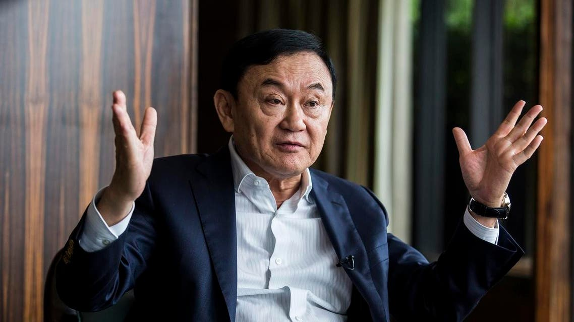 Exiled former Thai prime minister Thaksin Shinawatra being interviewed by Agence France-Presse in Hong Kong. (AFP)