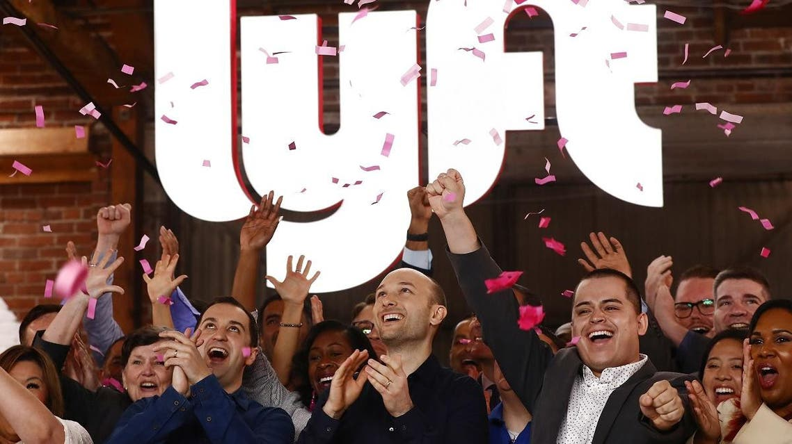 Confetti falls as Lyft CEO Logan Green (C) and President John Zimmer (Left C) ring the Nasdaq opening bell celebrating the company's IPO on March 29, 2019 in Los Angeles, California. (AFP)