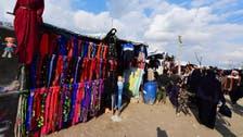 In Syria's desperate al-Hol camp, a market bustles