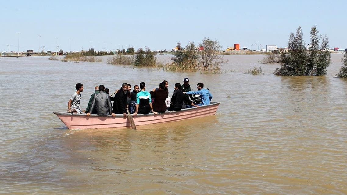 People are seen on a boat after a flooding in Golestan province, Iran. (Reuters)