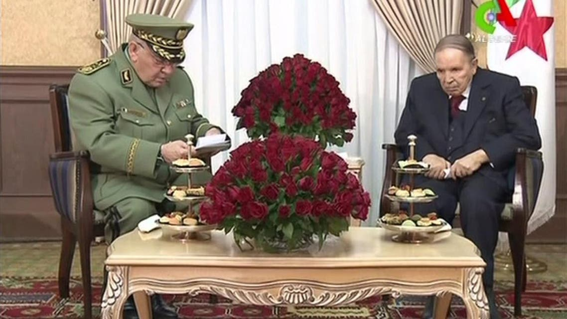 Algerian President Abdelaziz Bouteflika (R) meets with Algeria's army chief, Ahmed Gaid Salah in the capital Algiers. (AFP)