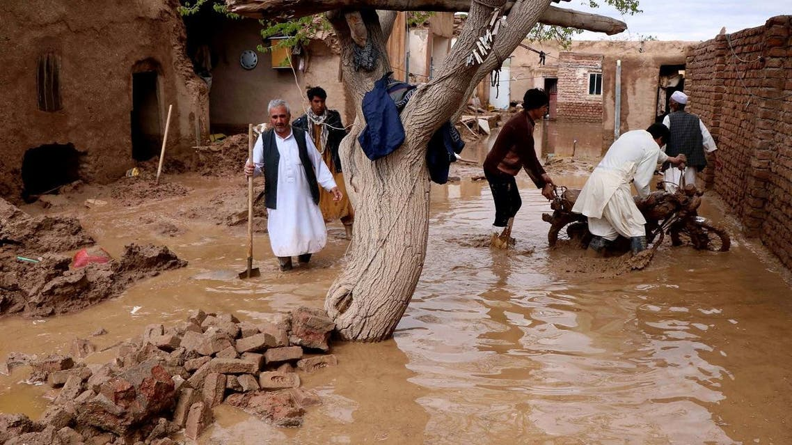 People salvage items from a house destroyed by flood in Enjil district of Herat province, Afghanistan March 29, 2019. (Reuters)