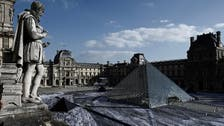 Amid gripes, Louvre pyramid celebrates 30 years with collage