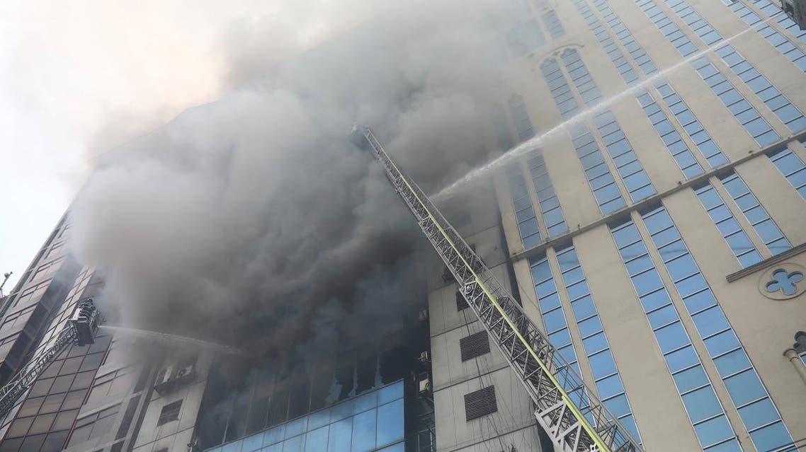 Firefighters attempt to extinguish a fire at a multi-storey commercial building in Dhaka. (File photo: Reuters)