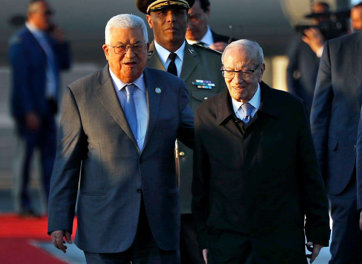 Tunisian President Beji Caid Essebsi (R) welcomes his Palestinian counterpart Mahmoud Abbas upon his arrival at Tunis-Carthage international airport on March 30, 2019, to attend the Arab Summit tomorrow. (AFP)
