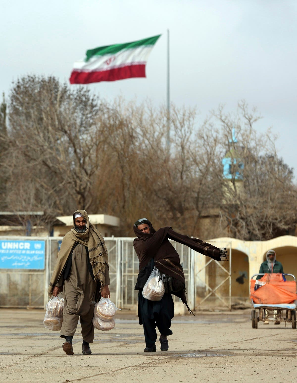 Afghans return to Afghanistan at the Islam Qala border with Iran, in the western Herat Province. (AP)