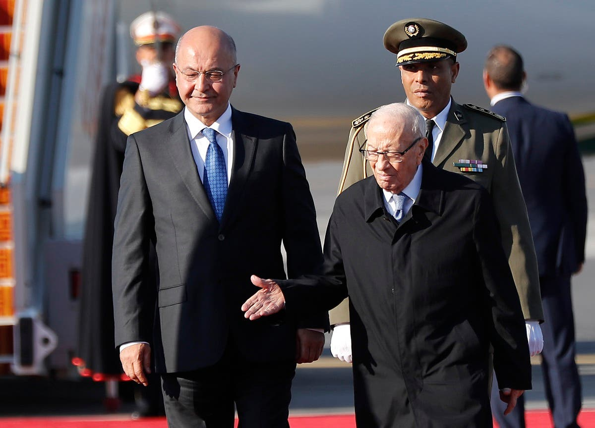 Tunisian President Beji Caid Essebsi (R) welcomes his Iraqi counterpart Barham Salih upon his arrival at Tunis-Carthage international airport on March 30, 2019, to attend the Arab Summit tomorrow. (AFP)
