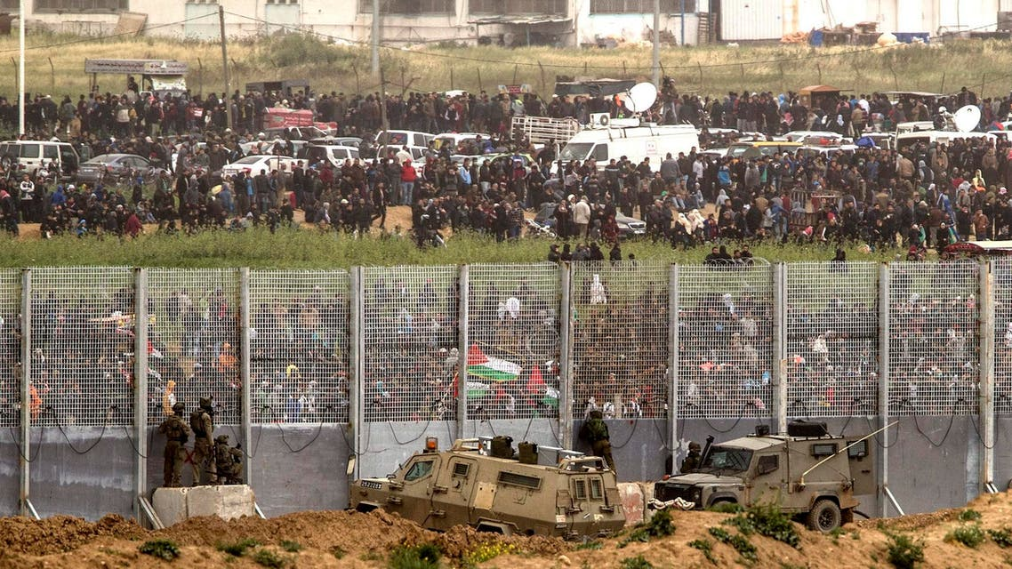 Israeli soldiers take positions on the Israel and Gaza border during a Palestinian protest, Saturday, March 30, 2019. (AP)