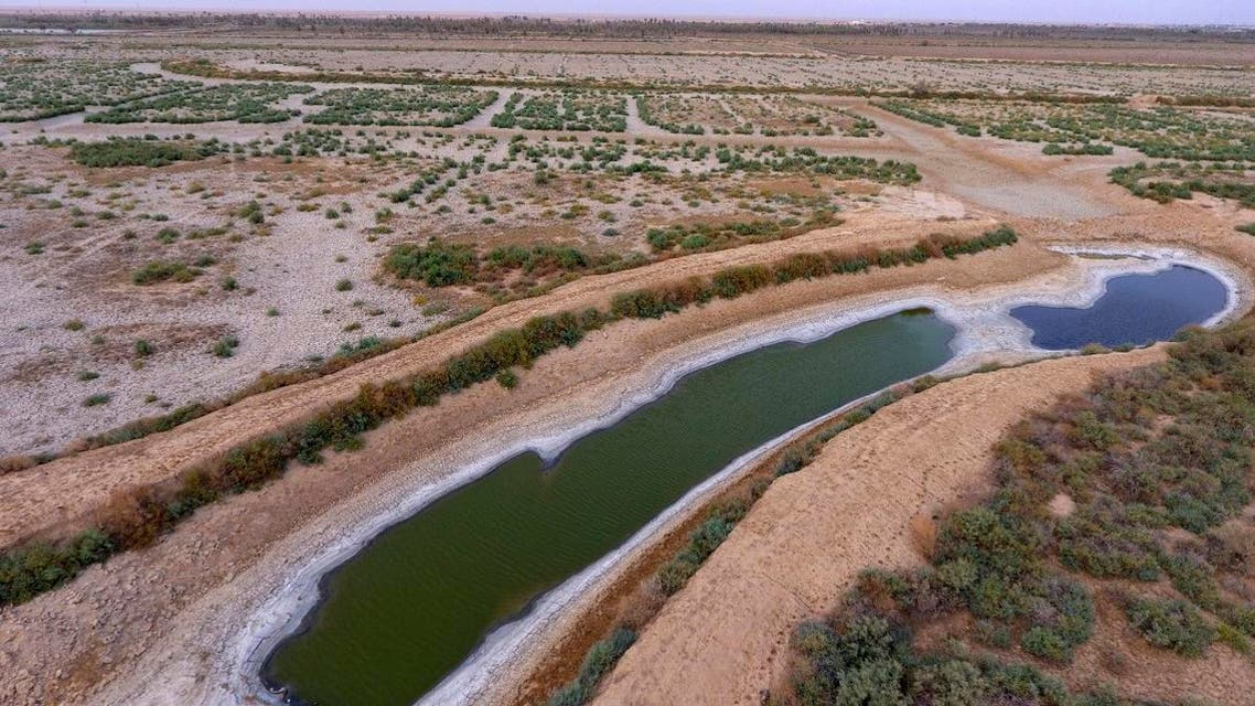 aerial photo shows a dry canal full of salt in the area of Siba in Basra, 550 km southeast of Baghdad, Iraq. (AP)