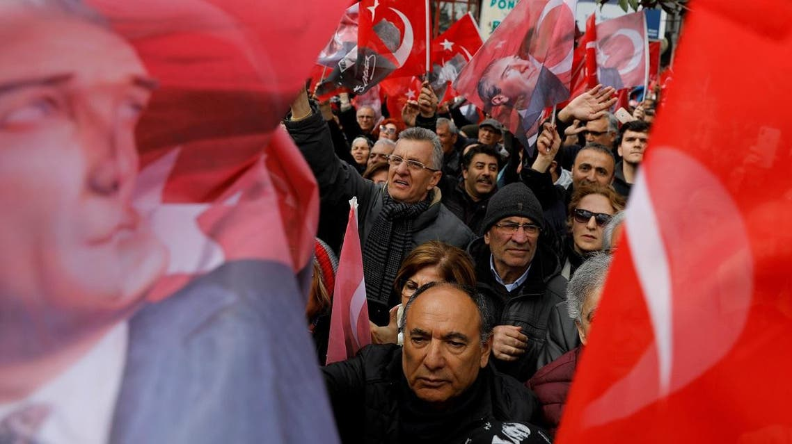 Supporters of the main opposition Republican People's Party mayoral candidate Imamoglu wave Turkish flags and portraits of Mustafa Kemal Ataturk during a rally for the upcoming local elections in Istanbul. (Reuters)