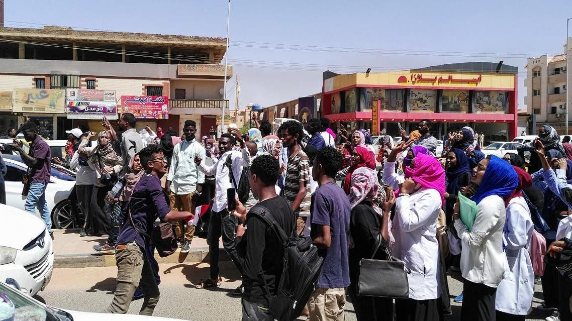 Protesters shout slogans during an anti-government demonstration in street 60 in the Sudanese capital Khartoum, on March 18, 2019. (AFP)