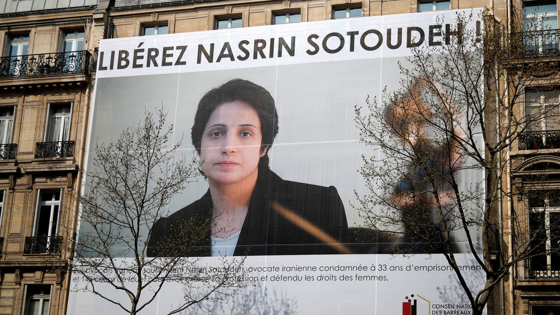 REFILE - ADDING RESTRICTIONS A banner with a giant portrait of jailed Iranian lawyer Nasrin Sotoudeh by Arash Ashourinia is seen on the headquarters of the French National Bar Council, demanding her release, in Paris, France, March 28, 2019. Nasrin Sotoudeh, an internationally renowned human rights lawyer jailed in Iran, has been sentenced to 38 years in prison and 148 lashes. REUTERS/Charles Platiau NO RESALES. NO ARCHIVES.