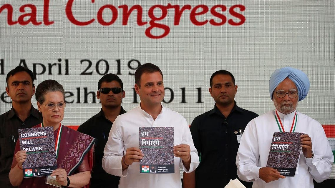 Rahul Gandhi (C), President of India's main opposition Congress party, his mother and leader of the party Sonia Gandhi and India's former Prime Minister Manmohan Singh (R) display copies of their party's election manifesto for the April/May general election in New Delhi, India, April 2, 2019. (Reuters)