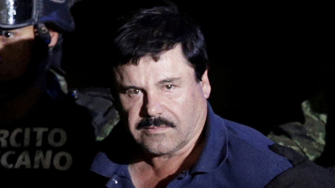 FILE PHOTO: Drug lord Joaquin El Chapo Guzman is escorted by soldiers at a hangar belonging to the office of the attorney general in Mexico City, Mexico, January 8, 2016. REUTERS/Henry Romero/File Photo/File Photo
