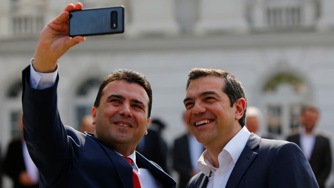 North Macedonia's Prime Minister Zoran Zaev and Greek Prime Minister Alexis Tsipras attend a welcoming ceremony in Skopje, North Macedonia April 2, 2019. REUTERS/Ognen Teofilovski