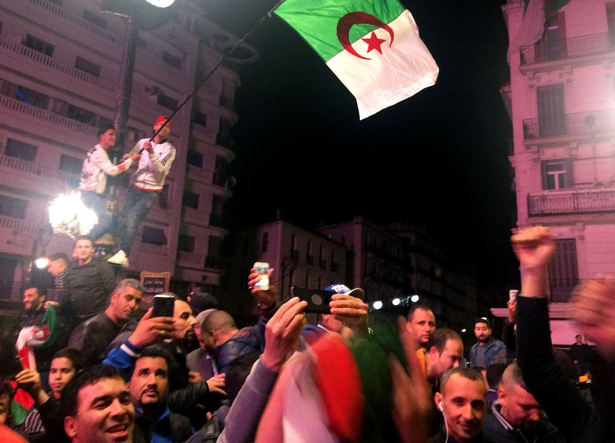 People celebrate on the streets after Algeria's President Abdelaziz Bouteflika has submitted his resignation, in Algiers on April 2, 2019. (Reuters)