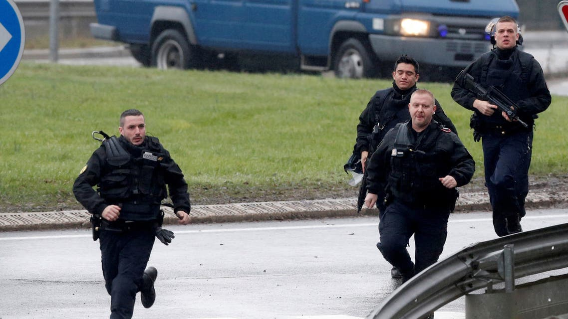 FILE PHOTO - Members of the French gendarmerie intervention forces arrive at the scene of a hostage taking at an industrial zone in Dammartin-en-Goele, northeast of Paris January 9, 2015. The two main suspects in the weekly satirical newspaper Charlie Hebdo killings were sighted in the northern French town of Dammartin-en-Goele where at least one person had been taken hostage, a police source said. REUTERS/Christian Hartmann/File Photo ATTENTION EDITORS - FRENCH LAW REQUIRES THAT FACES SPECIAL INTERVENTION POLICE FORCES ARE MASKED IN PUBLICATIONS WITHIN FRANCE