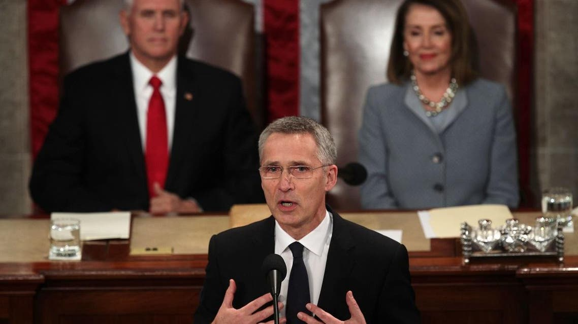NATO Secretary General Jens Stoltenberg addresses a joint meeting of the US Congress as Vice President Mike Pence and Speaker of the House Rep. Nancy Pelosi listen on April 3, 2019 at the US Capitol in Washington, DC. (AFP)