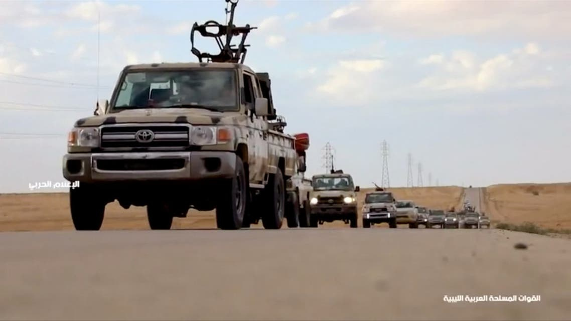 Pickup trucks with mounted weapons drive on a road in Libya, April 4, 2019, in this still image taken from video. Reuters TV via REUTERS