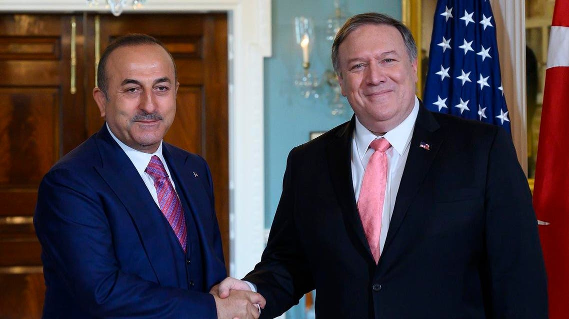 Pompeo and Turkey Foreign Minister Mevlut Cavusoglu. (AFP)