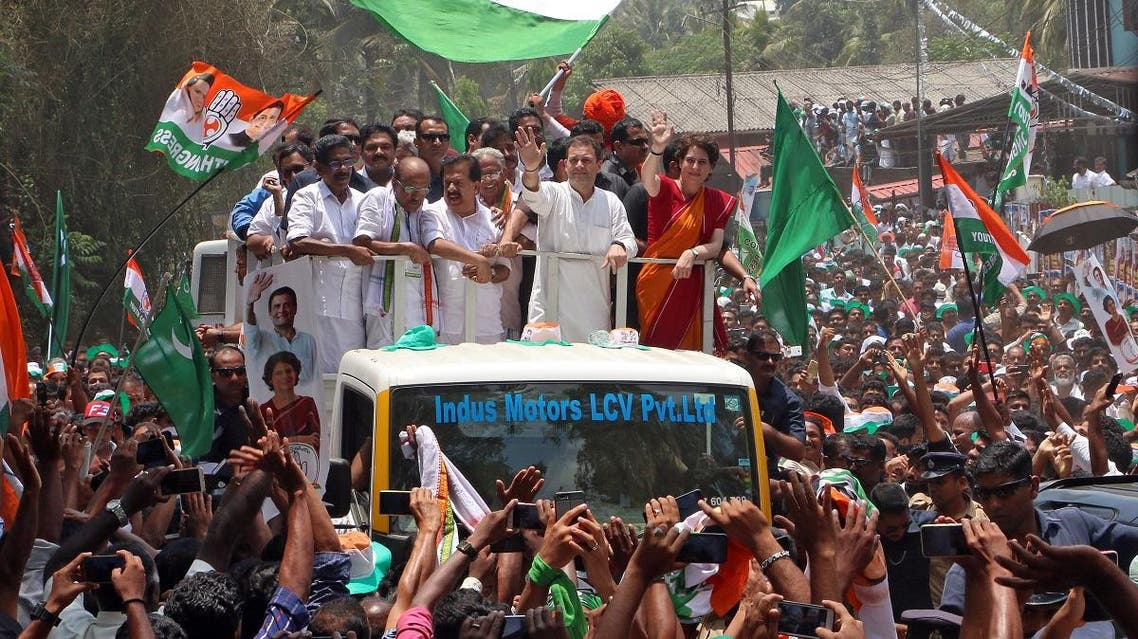 Rahul Gandhi, President of India's main opposition Congress party, and his sister a leader of Congress party Priyanka Gandhi Vadra, wave to their supporters after Rahul filed his nomination papers for the general election, in Wayanad in the southern state of Kerala, India, April 4, 2019. (Reuters)