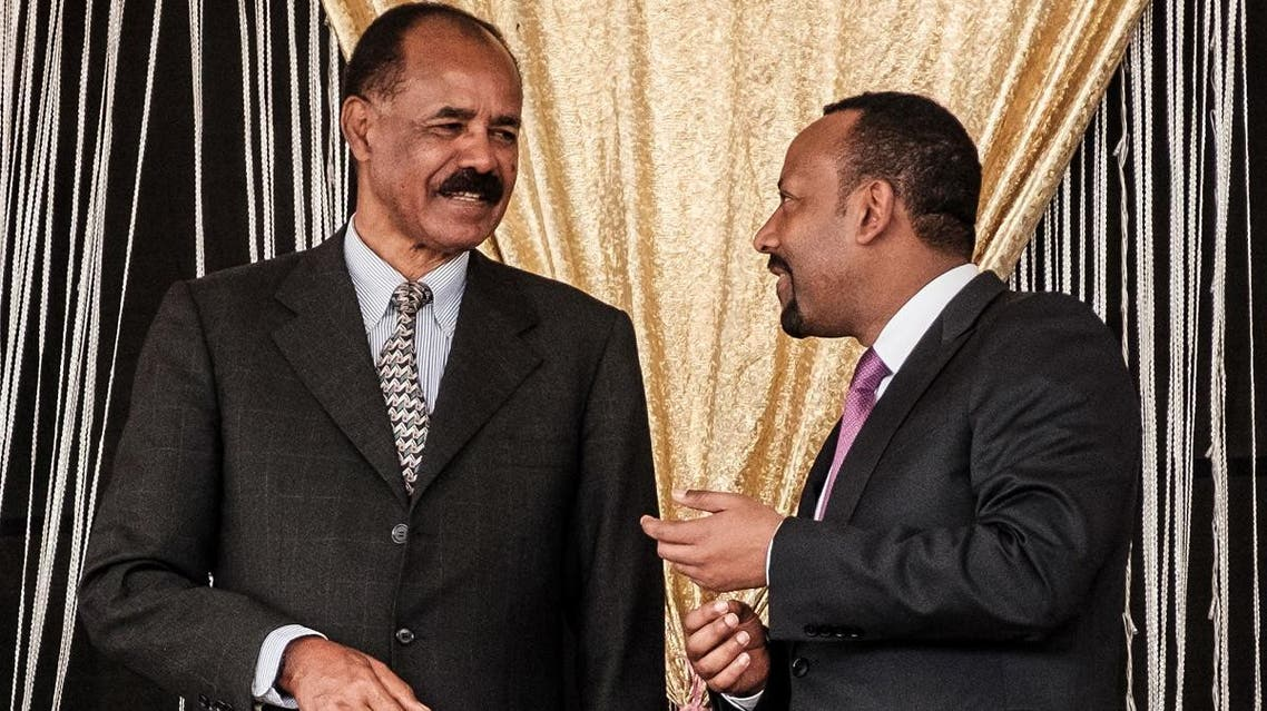 Eritrea's President Isaias Afwerki (L) and Ethiopia's Prime Minister Abiy Ahmed talk during the inauguration of the Tibebe Ghion Specialized Hospital in Bahir Dar, northern Ethiopia, on November 10, 2018. (AFP)