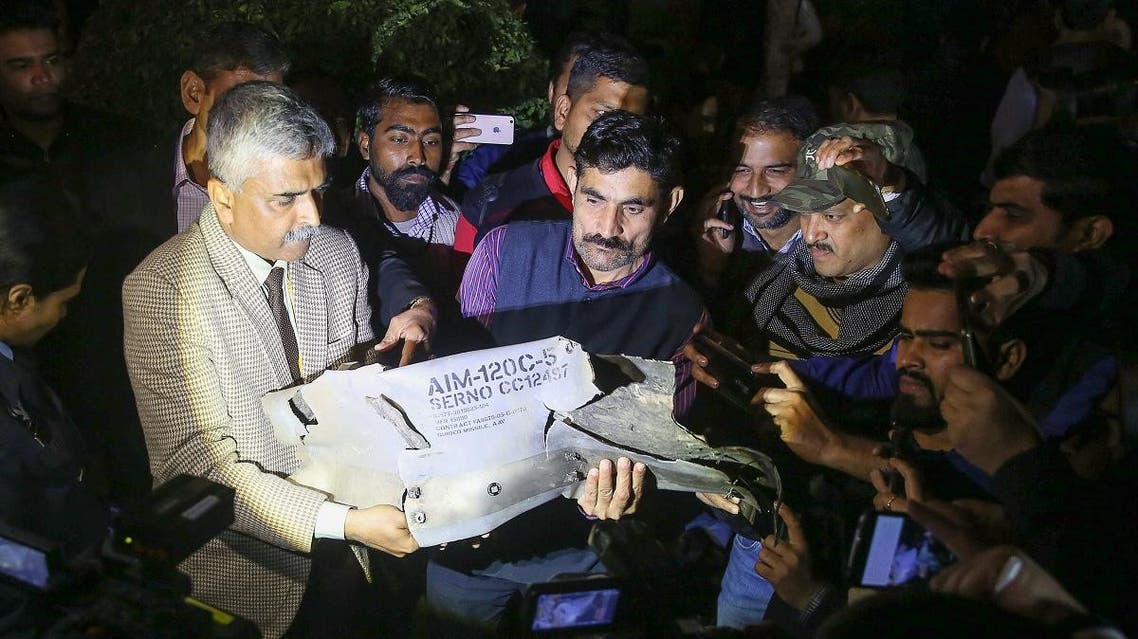 Indian Air Force officials show a section of an exploded AMRAAM missile, said to be fired by Pakistan Air Force (PAF) F-16, during a joint press conference of the Indian Air Force (IAF), Army and Navy in New Delhi on February 28, 2019. (AFP)