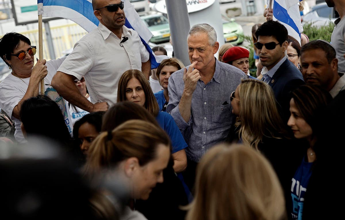 Retired Israeli general Benny Gantz (C), one of the leaders of the Blue and White (Kahol Lavan) political alliance, visits supporters in the Israeli city of Rehovot on April 5, 2019. (AFP)