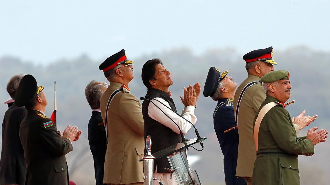 Pakistani Prime Minister Imran Khan (C) applauses as he is observes the fly-past by Pakistan Air Force (PAF) JF-17 Thunder fighter jet during the Pakistan Day military parade in Islamabad, Pakistan March 23, 2019. (Reuters)
