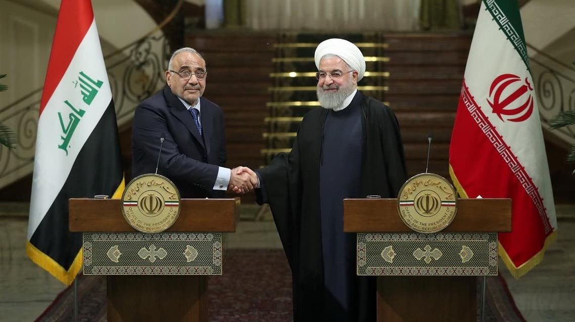 Iranian President Hassan Rouhani shake hands with Iraq's Prime Minister Adel Abdul Mahdi during a news conference in Tehran, Iran, April 6, 2019. (Reuters)