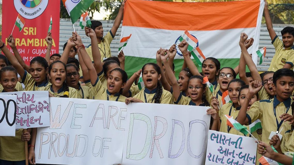 Indian students celebrate after India shot down a low-orbiting satellite as part of a successful test of a new missile technology by the Defence Research and Development Organisation (DRDO), in Ahmedabad on March 27, 2019.