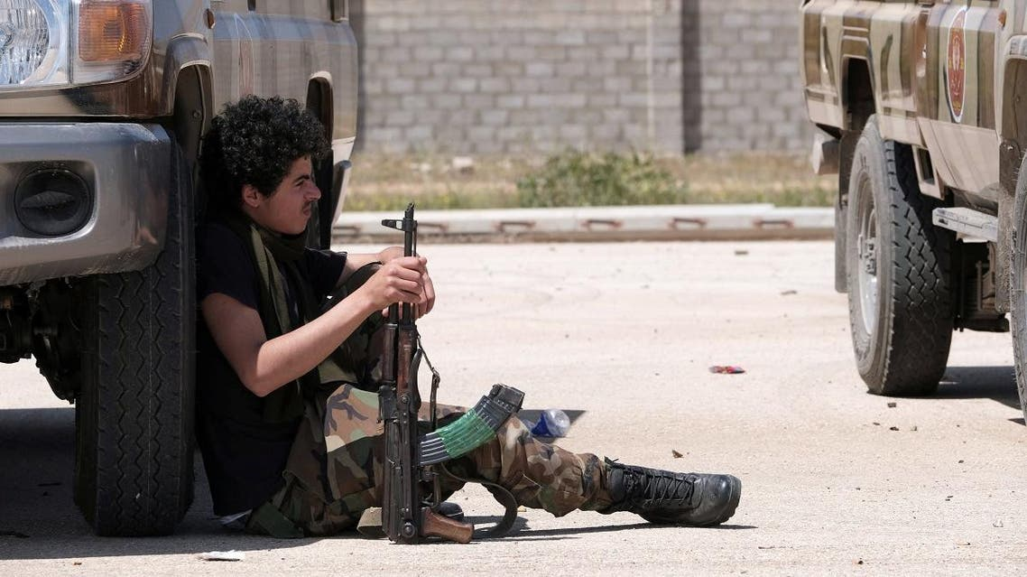 A member of Libyan National Army (LNA), commanded by Khalifa Haftar, holds his weapon as he heads out of Benghazi to reinforce the troops advancing to Tripoli, in Benghazi, Libya April 7, 2019. (Reuters)