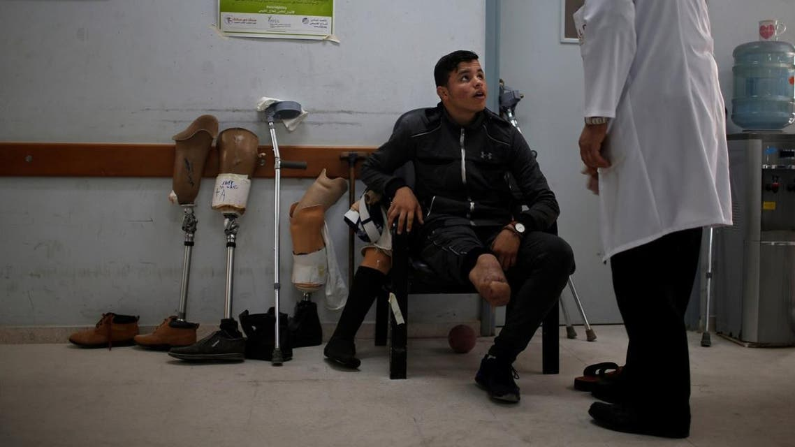Mohammad Alewa, 19, waits to be fitted with an artificial limb in Gaza City. (Reuters)