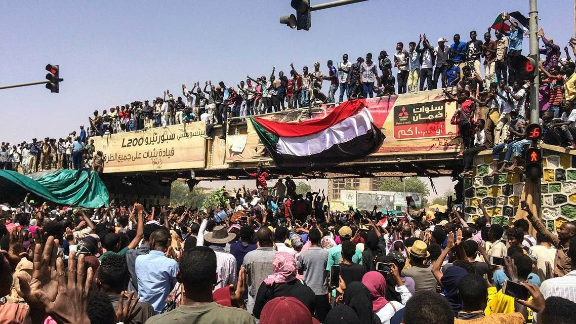 Protesters rally at a demonstration near the military headquarters on Tuesday in the capital Khartoum, Sudan. (AP)