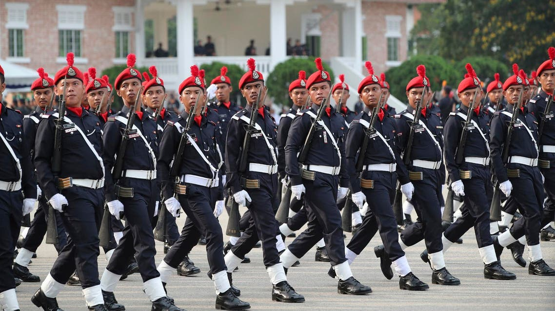 The Royal Malaysia Police guard of honor march during the Police Day parade in Kuala Lumpur on March 25, 2019. (AP)