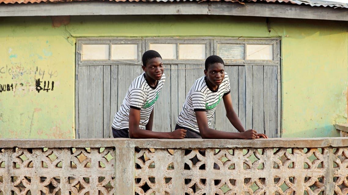 Identical twins Kehinde and Taiwo Kolawole pose in Igbo Ora town, Oyo State, Nigeria, on April 4, 2019. (Reuters)