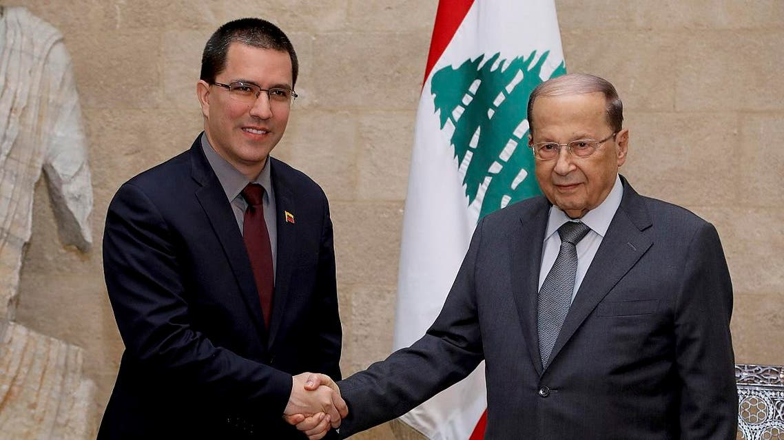Venezuelan Foreign Minister Jorge Arreaza, left, shakes hands with Lebanese President Michel Aoun, in Beirut, Lebanon, Wednesday, April 3, 2019. (AP)